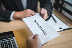 Businessman sending a resignation letter to employer boss in order to resign dismiss contract, changing and resigning from work. Concept stock photo