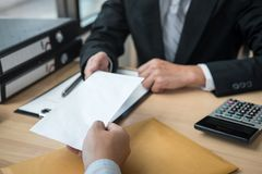 Businessman sending a resignation letter to employer boss in order to resign dismiss contract, changing and resigning from work. Concept royalty free stock images