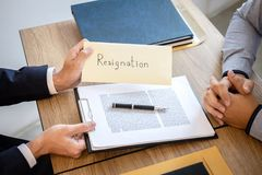 Businessman sending a resignation letter to employer boss in order to dismiss contract, changing and resigning from work concept.  stock images