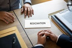 Businessman sending a resignation letter to employer boss in order to dismiss contract, changing and resigning from work concept.  royalty free stock photo