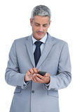Businessman sending text message Stock Photo