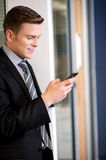 Businessman sending text message Royalty Free Stock Photo
