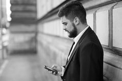 Businessman sending text message with his mobile phone Stock Photography