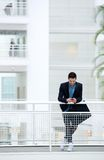 Businessman sending text message on mobile phone Royalty Free Stock Images
