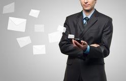 Businessman sends a virtual message Stock Image