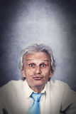 Businessman. Senior businessman angry face and grunge background Stock Photos