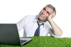 Businessman senior relaxed on green grass desk Royalty Free Stock Photos