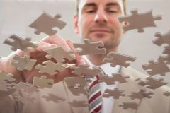 Businessman separating puzzle Royalty Free Stock Photography