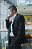 Businessman with serious expression looking off camera Royalty Free Stock Photography