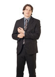 Businessman with serious face adjusting his shirt Royalty Free Stock Photography
