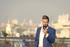 Businessman serious face received important message, skyline background. Message concept. Man in suit businessman takes. Advantages of modern mobile royalty free stock photos