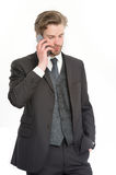 Businessman with serious face talk on mobile phone Royalty Free Stock Images