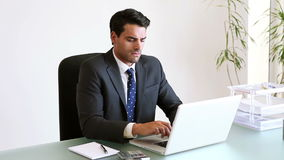 Businessman seriously working Stock Image