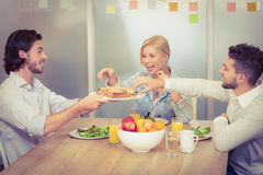 Businessman serving sandwiches during lunch Royalty Free Stock Images