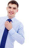 Businessman sets straight his tie Stock Images
