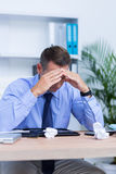 Businessman with severe headache sitting at office desk Royalty Free Stock Photo