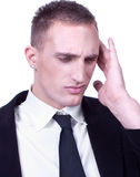 Businessman with severe migraine headache Stock Images