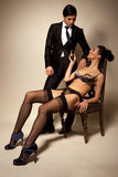 Businessman And Sexy Lady In Lingerie Stock Photo