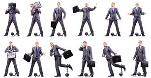 The businessman with shackles on white Stock Images