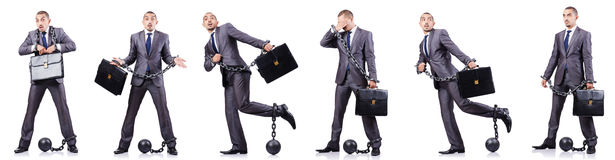 The businessman with shackles on white Royalty Free Stock Images