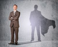 Businessman with shadow in cape Stock Images