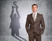 Businessman with shadow holding dollar sign Royalty Free Stock Image