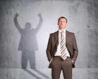 Businessman with shadow showing win Stock Image