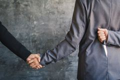 Businessman shake hand and betray Royalty Free Stock Photography