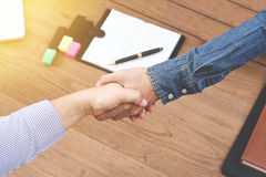 Businessman shake hand at the office in the morning Stock Image