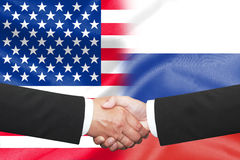 Businessman shakehand over half america half russian flag. Two businessman shakehand over half america half russian flag Stock Photography
