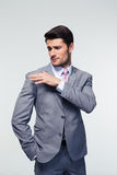 Businessman shakes off something from his shoulder Stock Photos