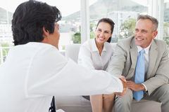 Businessman shaking a clients hand Stock Image
