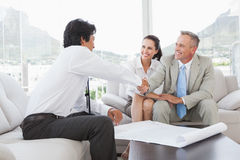 Businessman shaking a clients hand Royalty Free Stock Images
