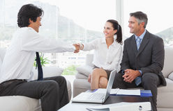 Businessman shaking a clients hand Stock Photos
