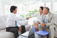 Businessman shaking a clients hand Royalty Free Stock Photography
