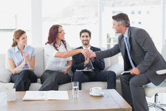Businessman shaking an employees hand Stock Photography