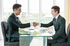 Businessman shaking hand, business situation Stock Images