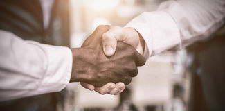 Businessman shaking hand with colleague Stock Images