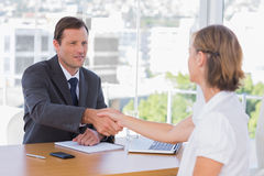Businessman shaking hand of a job applicant Stock Photography