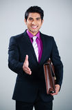 Businessman shaking hands Stock Images