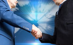 Composite image of businessman shaking hands Royalty Free Stock Photo