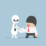 Businessman shaking hands with Alien Stock Photos