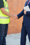 Businessman Shaking Hands With Builder On Construction Site Stock Image