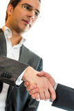 Businessman Shaking Hands with Business Partner Stock Photography