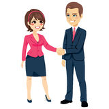 Businessman Shaking Hands Businesswoman. Businessman shaking hands with businesswoman happy standing negotiating Stock Photography