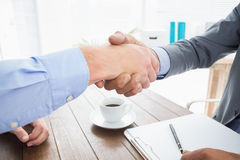 Businessman shaking hands with a co worker Royalty Free Stock Photos