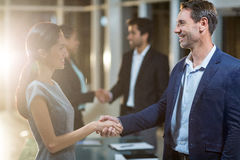 Businessman shaking hands with colleague Stock Photography