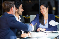 Businessman shaking hands with a colleague Stock Photos