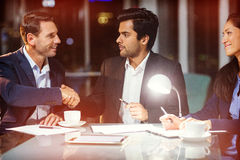 Businessman shaking hands with colleague Stock Images