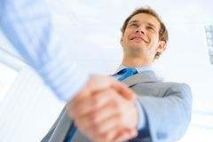 Businessman shaking hands with a colleague Royalty Free Stock Images